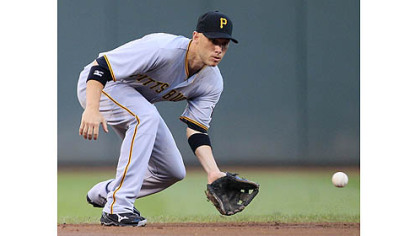 Pirates shortstop Clint Barmes fields a ground ball hit by the Reds&#039; Brandon Phillips in the first inning in Cincinnati. Barmes threw Phillips out at first.