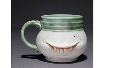 "Jason Kishell's ""Smug Mug"" is in the exhibition ""Humor in Craft"" at the Society for Contemporary Craft."