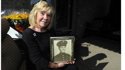 Marilyn Hendricks Claassen holds a portrait of her uncle Jack Yeager, a Marine tail gunner in World War II whose remains were found in the Pacific Islands in 2009 and are to be buried Saturday in New Kensington. Ms. Claassen wears his wedding ring on her right hand.