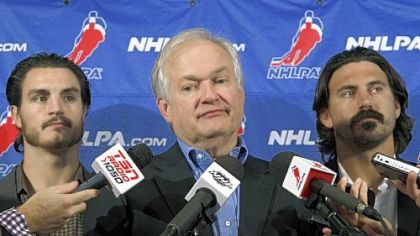 NHL Players&#039; Association executive director Don Fehr, center, said negotiations are possible before the CBA expires Saturday.