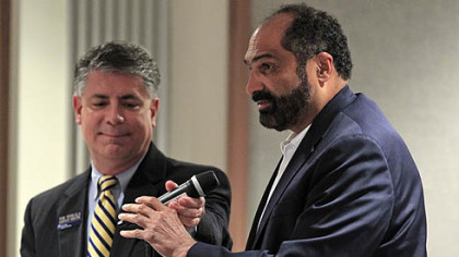 Former Steeler and Penn State alumnus Franco Harris has the microphone taken away from him during an open public forum before the Penn State Board of Trustees in State College today. Harris was not one of the seven people who were chosen in advance to ask questions.