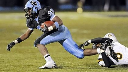 Seneca Valley's Forrest Barnes runs for a first down as he's taken down by North Allegheny's Elijah Zeise in September 2011. North Allegheny won, 49-28.