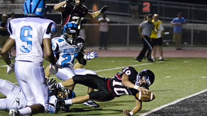 Gail Witenske shared this photo of Upper St. Clair senior quarterback Pete Coughlin diving into the end zone for a fourth-quarter touchdown against Woodland Hills on Aug. 31. Upper St. Clair won the game, 31-12.