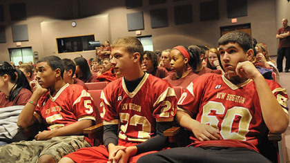 Three members of the junior high football team from New Brighton Middle School, left-right Robert Gibbons, 14, Brendon Duschene, 14, and Matthew Hall, 14, wait for the start of a program about Rachel&#039;s Challenge, created to use the life and writings of Rachel Joy Scott, who was the first victim in the 1999 Columbine school shootings, to encourage people to treat each other with respect.