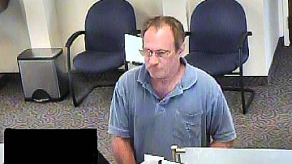 "A photo captured from video Sept. 10 in an Erie bank of the robbery suspect known as the ""Bucket List Bandit,"" identified by the FBI as Michael Eugene Brewster."
