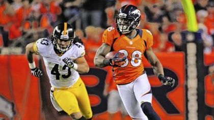 Broncos receiver Demaryius Thomas carries the ball ahead of Troy Polamalu for a 71-yard touchdown in the third quarter Sunday in Denver.