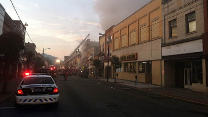 The fire early this morning along Merchant Street in Ambridge forced residents to flee though heavy smoke.