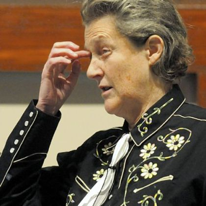 Temple Grandin, shown during an appearance here earlier this year, says taking dogs off a leash lets them know it is time to play.