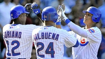 The Cubs' Starlin Castro celebrates with teammates Alfonso Soriano and Luis Valbuena Friday after hitting a three-run home run in the sixth inning against the Pirates in Chicago.