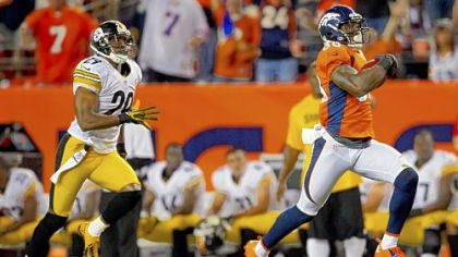 Broncos receiver Demaryius Thomas runs for a 71-yard touchdown against Steelers safety Ryan Mundy Sunday in Denver.