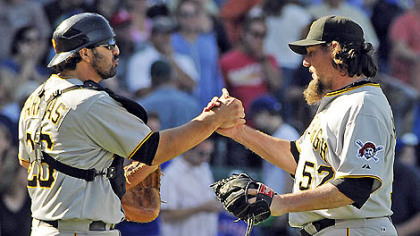 Pirates relief pitcher Joel Hanrahan, right, and catcher Rod Barajas celebrate the Pirates&#039; win against the Chicago Cubs this afternoon in Chicago.