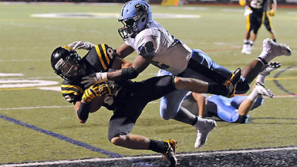North Allegheny's Gregg Garrity scores a touchdown Friday against Seneca Valley's Forrest Barnes.