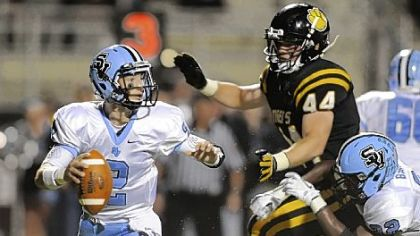 Seneca Valley quarterback Jordan Brown scrambles Friday as he's defended by North Allegheny's Kevin Edwards.