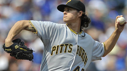 Pirates starter Jeff Locke delivers in the first inning against the Cubs in Chicago.