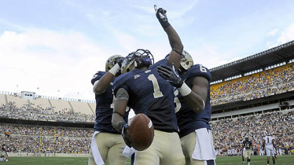 Pitt's Ray Graham celebrates a touchdown against Virginia Tech with teammates Devin Street and Drew Carswell in the third quarter Saturday at Heinz Field.