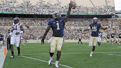 Pitt's Ray Graham scores a touchdown against Virginia Tech in the third quarter of today's game at Heinz Field.