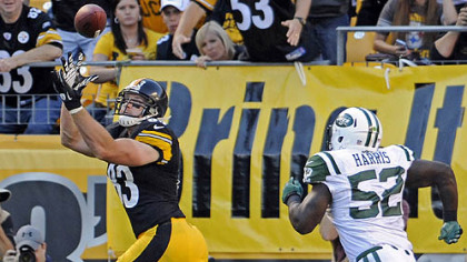 The Steelers&#039; Heath Miller pulls in a pass for a touchdown as he&#039;s defended by the Jets&#039; David Harris in the second quarter at Heinz Field.