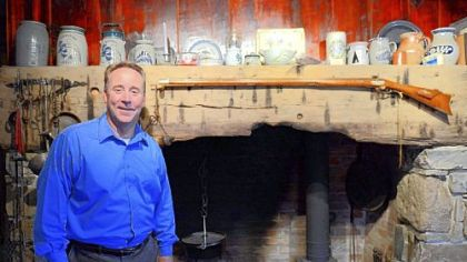 David Pancake stands in front of the original fireplace in his home built in 1780, outside Romney in Hampshire County, W.Va.