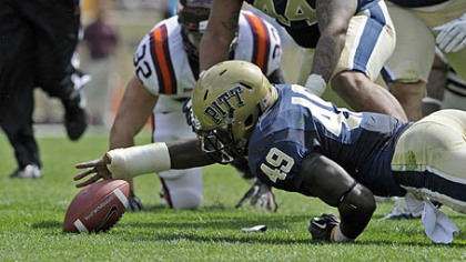 Pitt's Eric Williams reaches to recover a fumble against Virginia Tech in the second quarter of today's game at Heinz Field.