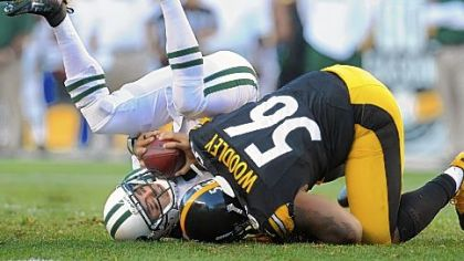 Steelers linebacker LaMarr Woodley sacks Jets quarterback Mark Sanchez.