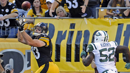 Heath Miller pulls in a pass for a touchdown as he's defended by the Jets' David Harris in the second quarter at Heinz Field Sunday.