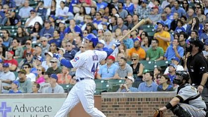 The Cubs&#039; Anthony Rizzo hits a grand slam home run against the Pirates in the sixth inning.