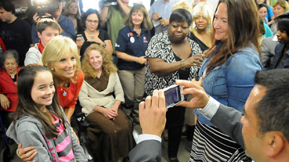 Jill Biden poses for a photo with Mairyn McFall, 9, of Murrysville following Ms. Biden's talk at a Women for Obama campaign event at the Obama campaign office in the Strip District.