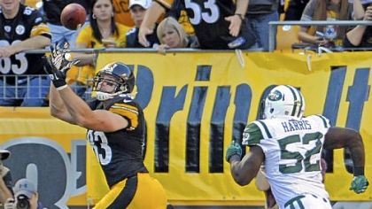 The Steelers' Heath Miller pulls in a pass for a touchdown as he's defended by tghe Jets' David Harris in the second quarter at Heinz Field Sunday.