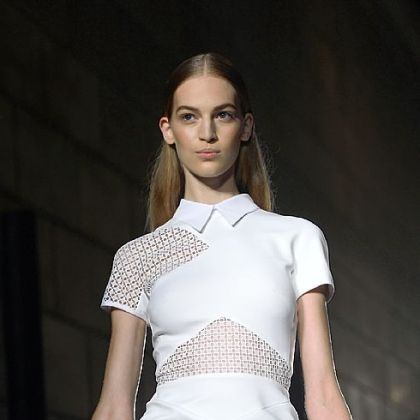 A model displays an outfit by designer Victoria Beckham.