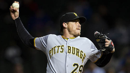 Pirates' pitcher Kevin Correia picked up his 11th win while pitching seven scoreless innings in the rain-delayed victory Monday night over the Cubs.