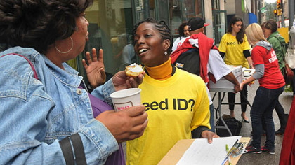 "Monel Walker, left, from Braddock, receives reassurance about her voter identification from Marian Schneider, a local attorney volunteering at the ""My Vote, My Right"" awareness event held in front of the PennDOT office on Smithfield Street in Pittsburgh today."