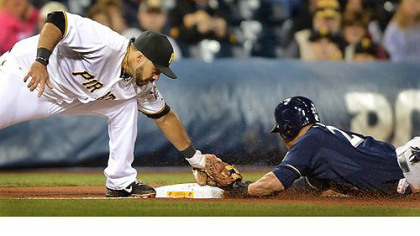 Pirates third baseman Pedro Alvarez tags out the Brewers' Carlos Gomez as he was caught stealing.