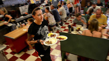 Lori Robinson serves up breakfast at DeLuca's in the Strip District.