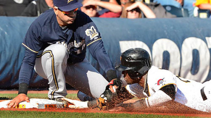 Brewers third baseman Aramis Ramirez tags out Pirates&#039; Starling Matre.