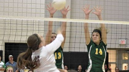 Blackhawk&#039;s Hannah Pringle (13) and Nikki Beatty (14) block against Uniontown at the Upper St. Clair Tournament.