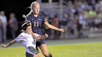 Blackhawk&#039;s Lia Vincuguerra kicks the ball away from Hopewell midfielder Abby Losco, right, during a section match last week.