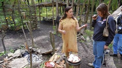 Dianne Anestis prepares meal using traditional American Indian foods and cooking methods.
