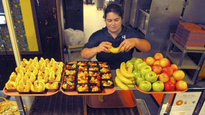 Samantha Hiller arranges fresh fruit for seventh- and eighth-graders in the Quaker Valley School District.
