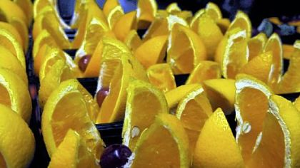 Slices of oranges are arranged at lunchtime at Anthony Wayne Middle School.