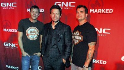 Mark Wahlberg flanked by Brad Arnold, left, and Chris Henderson of 3 Doors Down at Stage AE on the North Side.