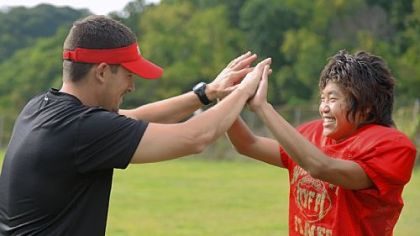 Dil Subba, 16, from Nepal, high-fives his football coach T.J. Wiley Monday during practice at Northgate High School in Bellevue.