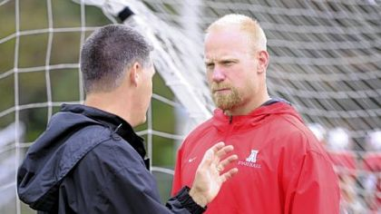 Avonworth assistant coach Chris Hoke, right, talks with head coach Duke Johncour at practice Tuesday.