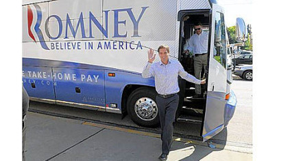 Josh Romney, presidential candidate Mitt Romney's third-born son, gets off his campaign bus to speak at a campaign event in Rochester Thursday afternoon.