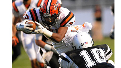 Tyler Boyd dives into the end zone after scrambling, giving Clairton the first touchdown of the game Thursday against Monessen.