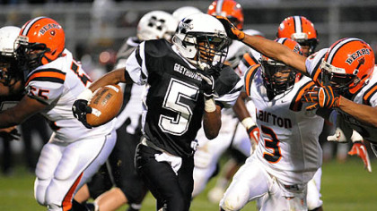 Monessen's Javon Brown looks to turn the corner and pick up yardage Thursday against Clairton.