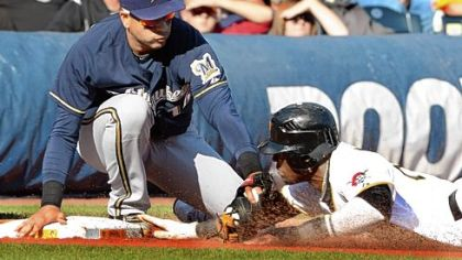 Brewers third baseman Aramis Ramirez tags out Pirates left fielder Starling Marte Thursday at PNC Park.