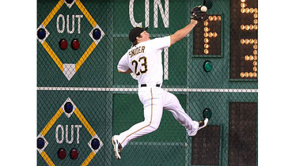 Pirates right fielder Travis Snider crashes in to the right field wall on double hit by the Brewers' Norichika Aoki to score the first run in Milwaukee's four-run rally in the eighth inning Thursday at PNC Park.