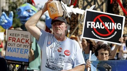 Ray Kemble of Dimock, Pa., on Thursday marches with a jug of his well water outside a Marcellus Shale industry conference where Gov. Tom Corbett attacked anti-drilling activists as the &quot;unreasoning opposition.&quot;