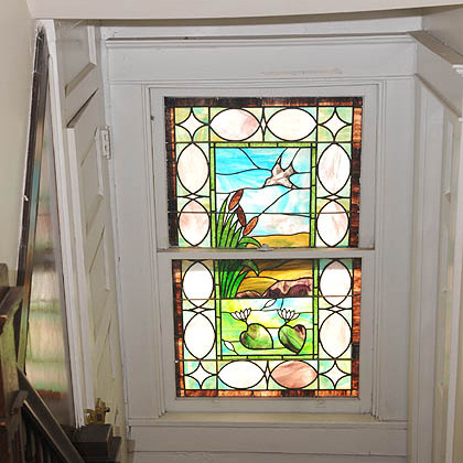 A stain glass window in the stairwell