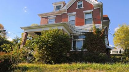 This five-bedroom, three-story brick house in West Mifflin is on the market for $109,900.